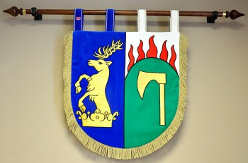 Embroidered banner of arms in the shape of a shield