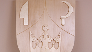 Wood carved and sandstone coats of arms