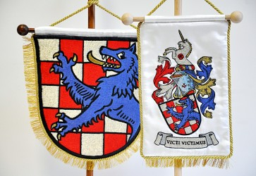 Close-up on the embroidery on the table flags bearing the coat of arms