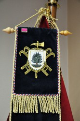 Close-up of the embroidery on the ribbon, coat of arms of the fire brigade