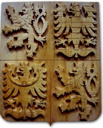 Wood carved coat of arms of the Czech Republic in dark color version