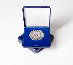 Commemorative coin in a box