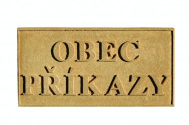 Sandstone sign with the name of a town