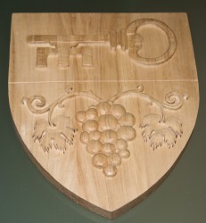 Custom-made wood carved coats of arms