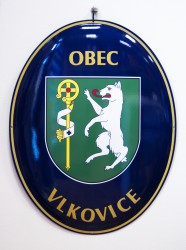 Enamel oval sign with a coat of arms and the name of a village/town/township