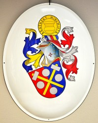 An example of a rendition of a personal heraldic achievement on an enamel oval sign