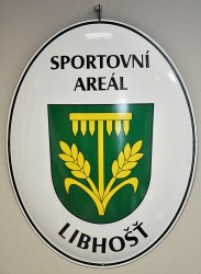 Enamel oval welcome sign designating an entrance of an area