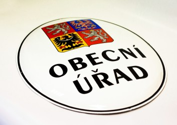 The coat of arms of the Czech Republic on an enamel oval sign