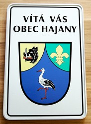 Welcome sign with a coat of arms and a name of a village/town/township (sandwich sheet metal)