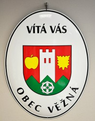 White enamel welcome sign for the municipality of Věžná