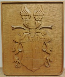 Wood carved rendition of a personal heraldic achievement
