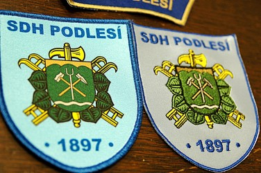 Examples of printed and embroidered shoulder patches [Volunteer Fire Brigade (SDH) Podlesí]