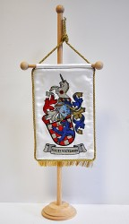 An example of a rendition of a personal heraldic achievement on an embroidered table flag